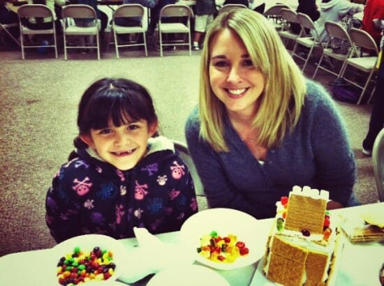 Julianna and Carla were all smiles while building their gingerbread house